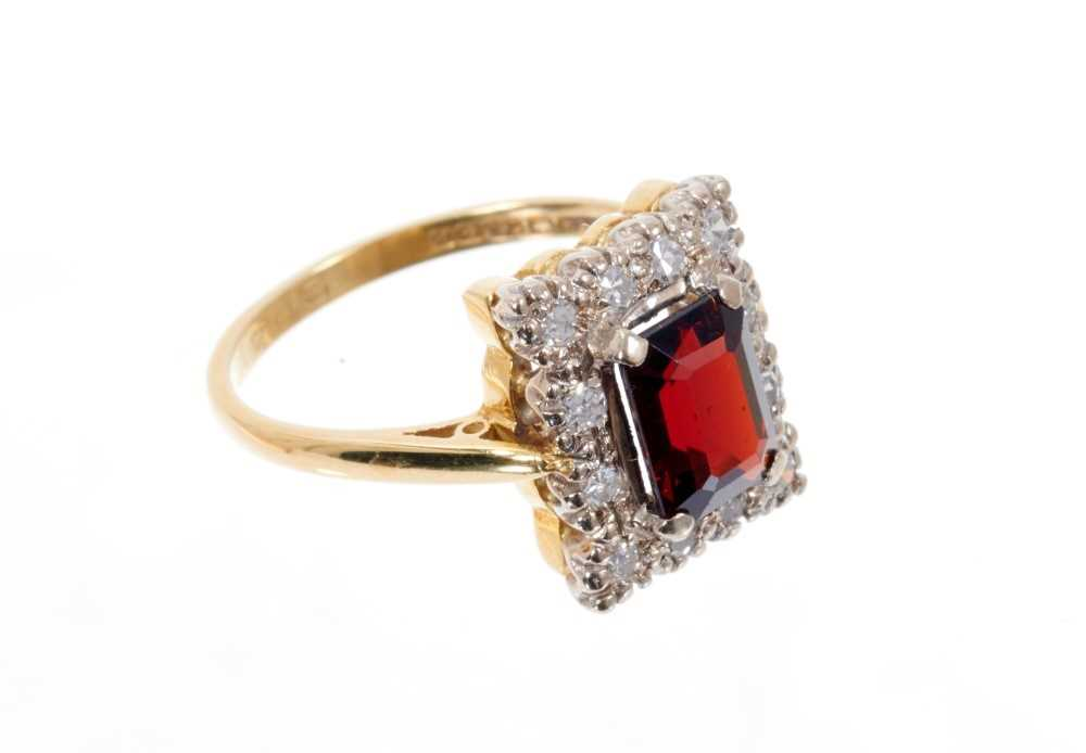 Garnet and diamond cluster ring with a rectangular step cut garnet surrounded by a border of single - Image 2 of 3