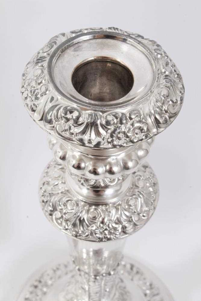 A set of four Old Sheffield plate candlesticks with scroll, shell and floral borders - Image 3 of 4