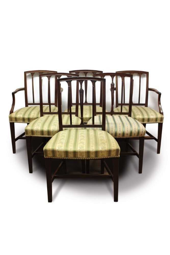 Set of eleven George III style mahogany dining chairs, each with vertical bar back and striped uphol
