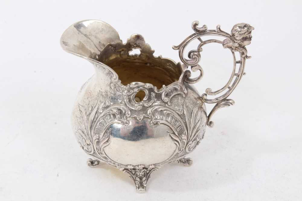 Victorian silver cream jug of baluster form, with scroll handle, on three paw feet - Image 2 of 5