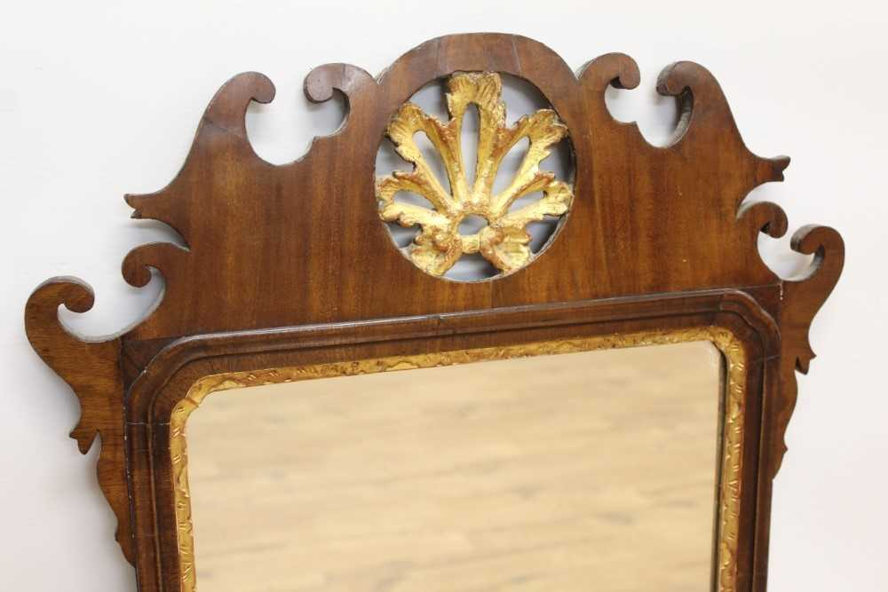 George II style mahogany fret carved wall mirror, the pierced carved top centred with a gilt floral - Image 2 of 4