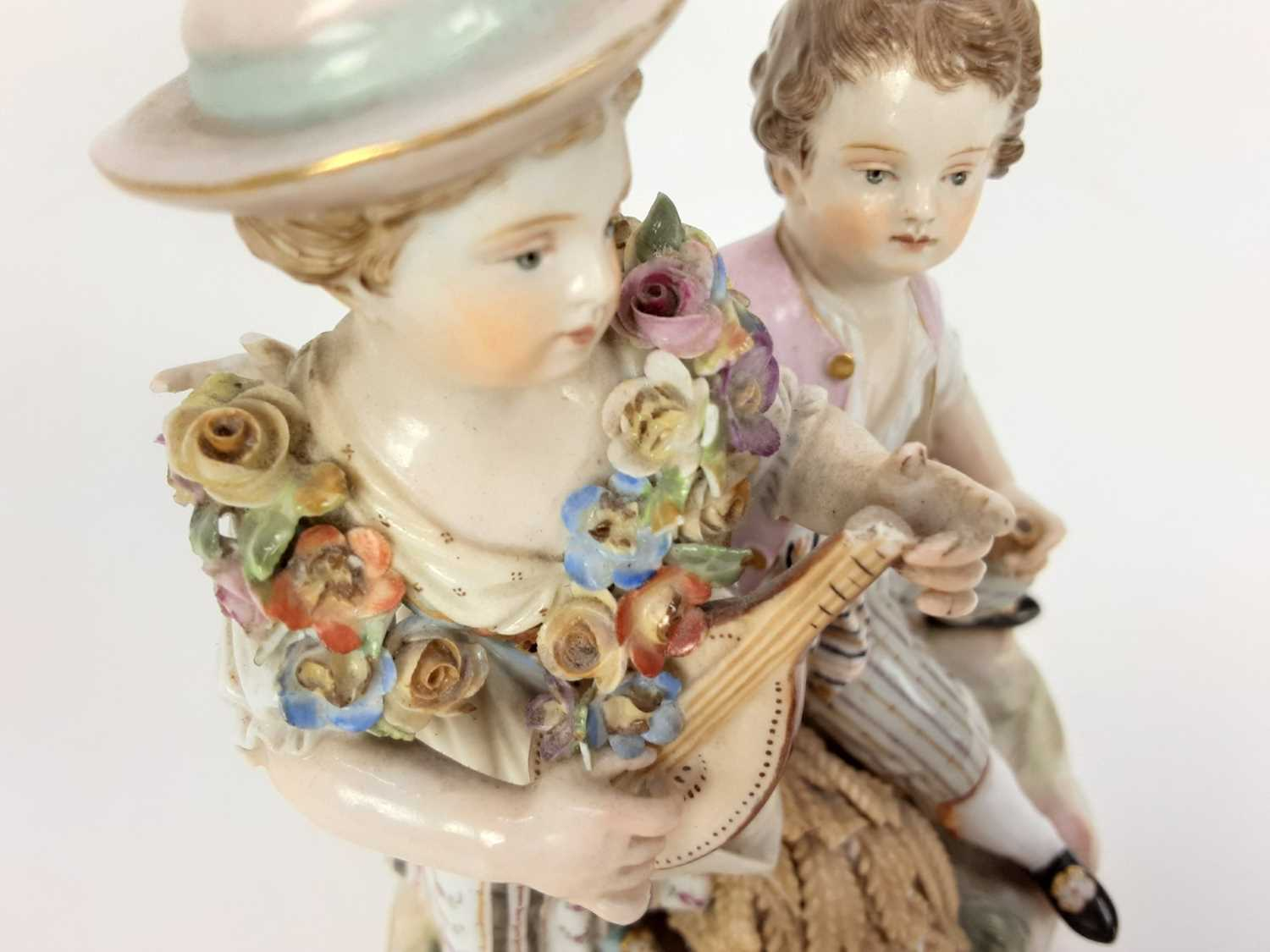Meissen porcelain group, late 19th century, the boy sat on a sheaf of wheat, listening to a girl pla - Image 6 of 9