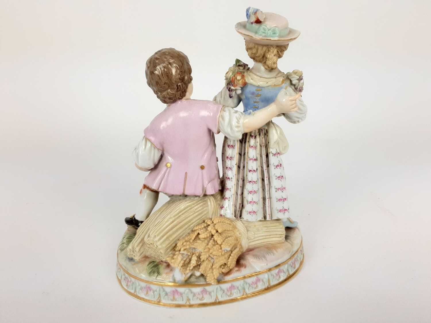 Meissen porcelain group, late 19th century, the boy sat on a sheaf of wheat, listening to a girl pla - Image 3 of 9