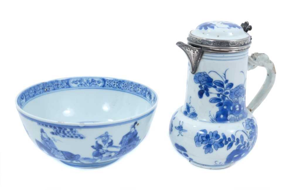 Chinese Kangxi porcelain jug and cover with later silver mount, together with a bowl (2)