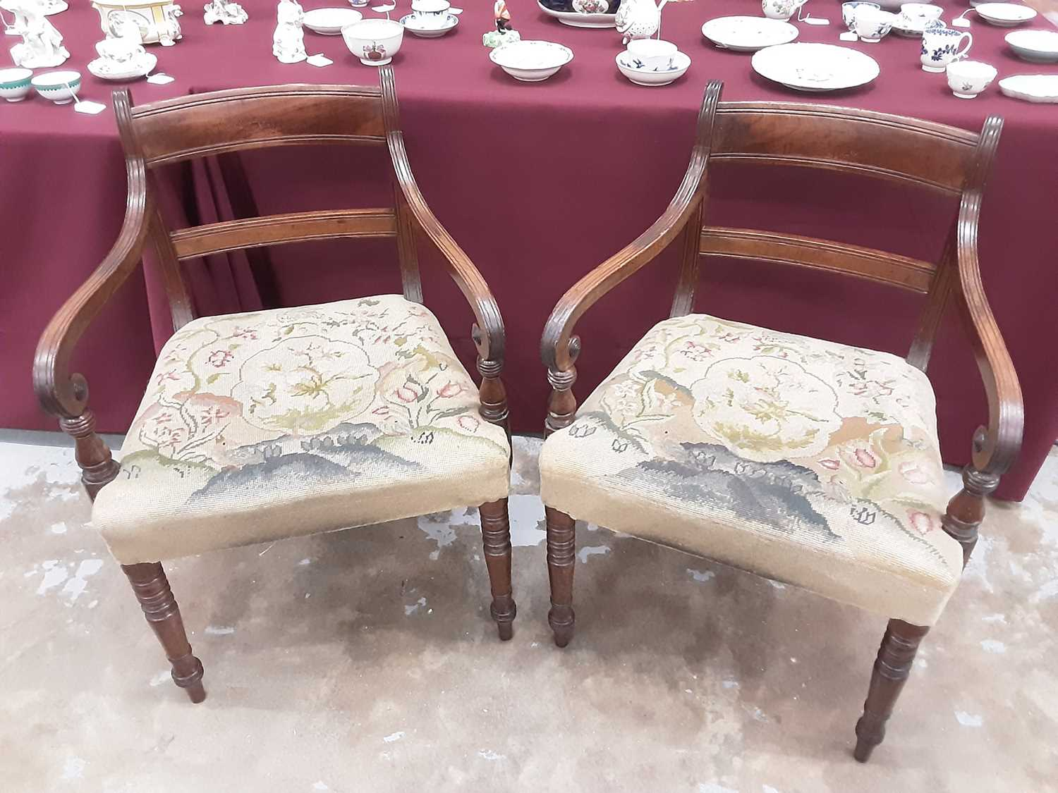 Set of eight Regency mahogany dining chairs, each with bar back and tapestry seat on ring turned leg