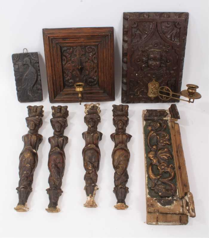 Collection of 17th century and later carved panels and furniture mounts