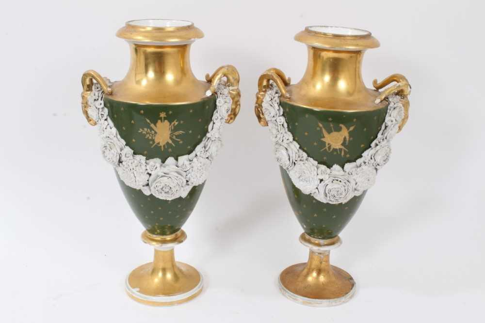 Pair of Paris porcelain vases, 19th century, decorated with swags of encrusted flowers on a green an