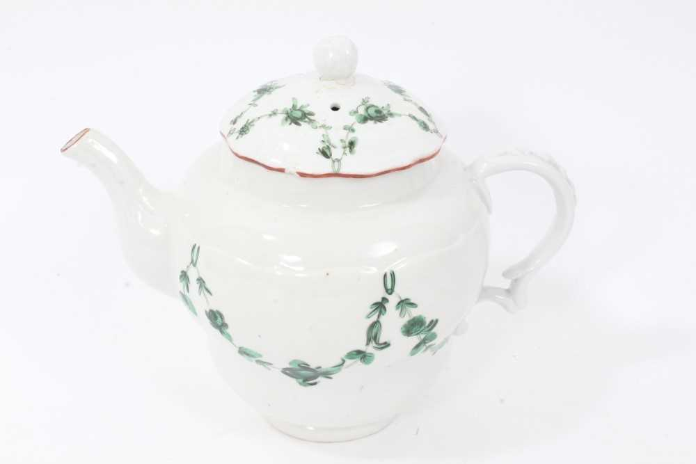 Bristol ogee shaped teapot and cover, circa 1772, with green-painted swags of flowers, the spout and