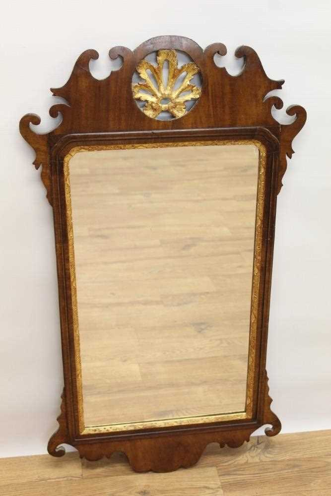 George II style mahogany fret carved wall mirror, the pierced carved top centred with a gilt floral