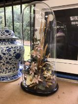Victorian glass dome containing bird of paradise and silk flower display