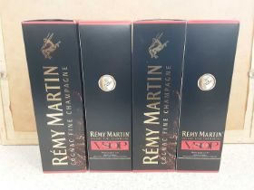 Four bottles of Remy Martin Cognac Fine Champagne 70cl, in original boxes