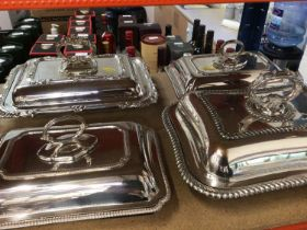 Four silver plate entree dishers - A pair by Hamilton & Inches of Edinburgh, a single on coopper and