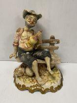 Capodimonte Figure of Man on Bench