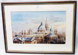 A framed coloured print, depicting cathedral spires and other rooftops