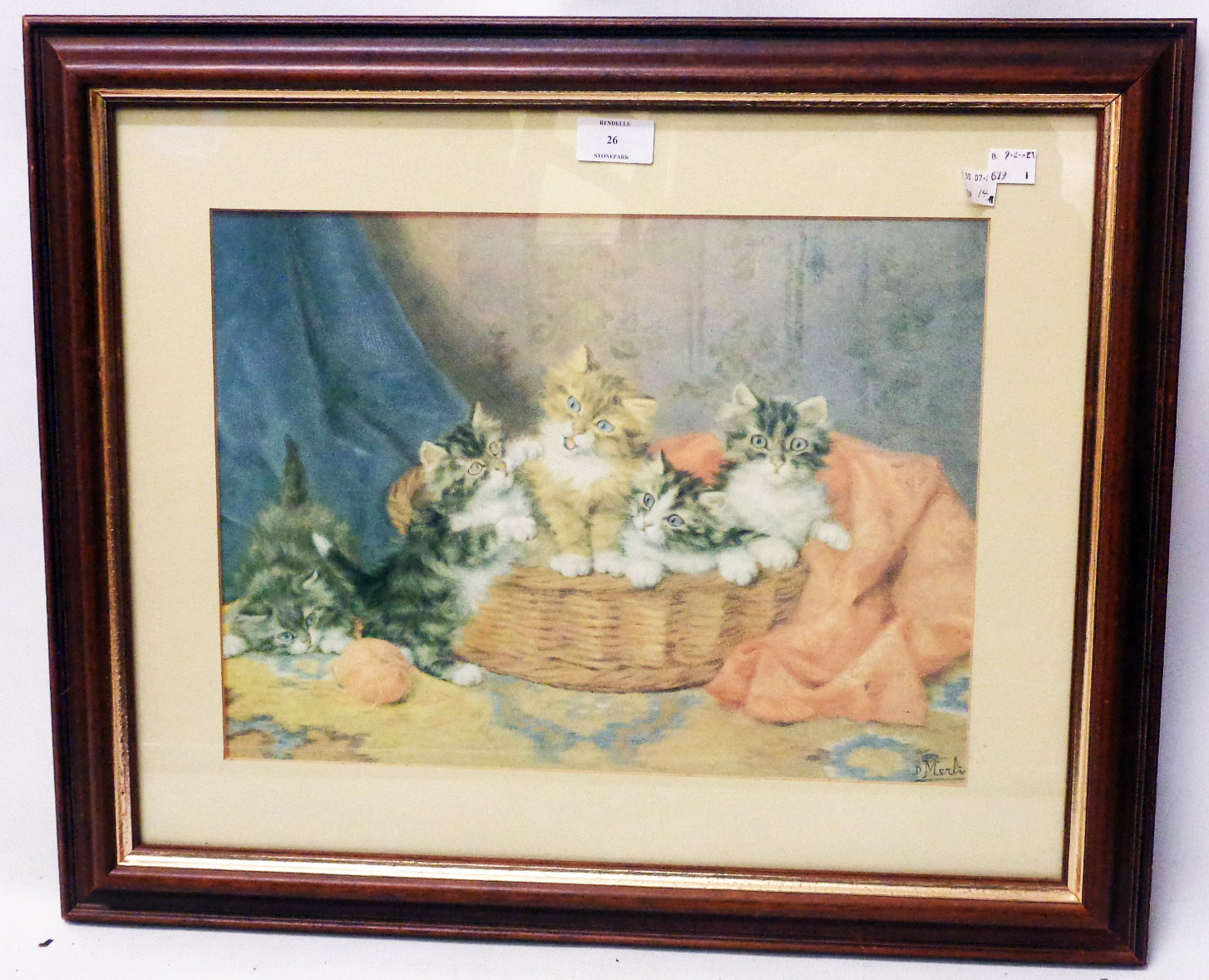 A framed coloured print, depicting kittens in a basket