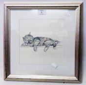 A framed monochrome print, depicting a kitten sleeping on a shelf