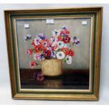 A gilt framed oil on canvas under glass still life with pot of flowers - indistinctly signed