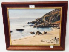 J. C. Houghton: a modern framed oil on canvas view of a Westcountry beach with rocks and figures