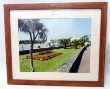 A framed photograph, depicting the esplanade in Torquay