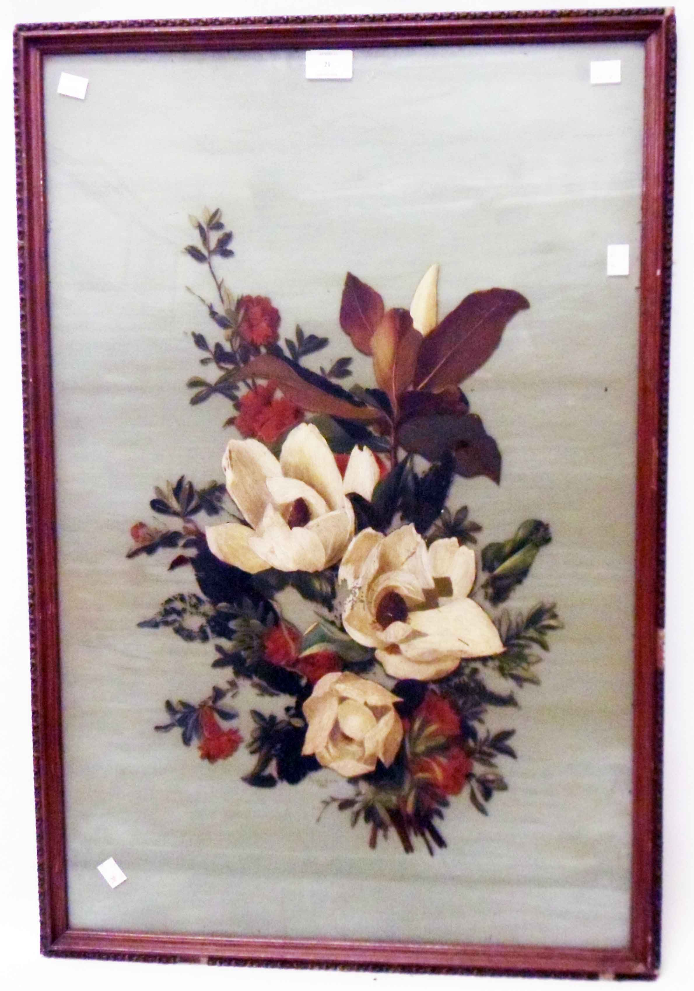 A framed oil painting on glass still life spray of flowers