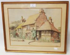 †B. E. Macdonald: a gilt framed watercolour, depicting a Tudor style country house - signed