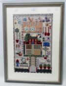 A framed modern woolwork sampler style panel with central cottage within kitchen themed border