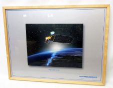 A large framed coloured print, depicting the Aqua Spacecraft (Northrop Grumman)