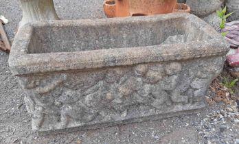 A concrete trough planter