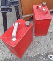 Two later painted Esso petrol cans