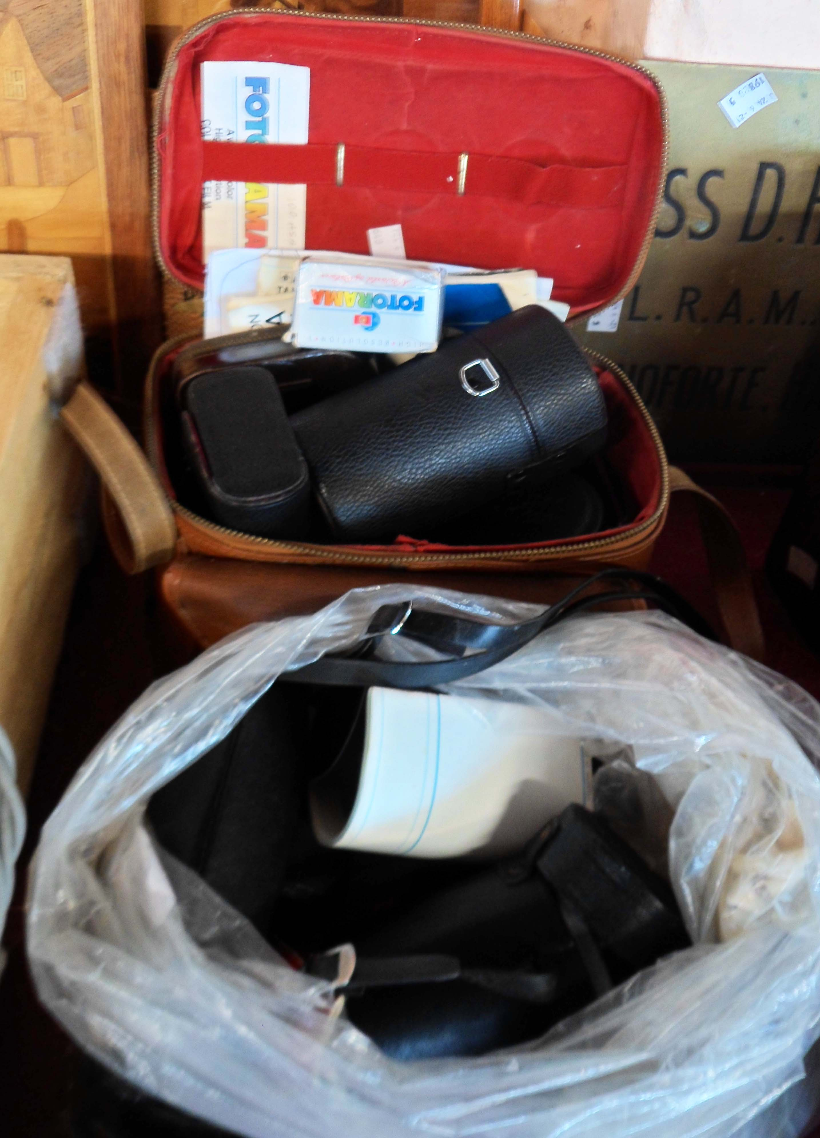 A cased Praktica camera and assorted lenses - sold with an Olympus Pen and assorted lenses