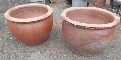 A pair of large salt glazed stoneware garden pots