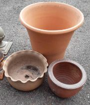 Three garden pots comprising one large terracotta, small salt glaze stoneware and another