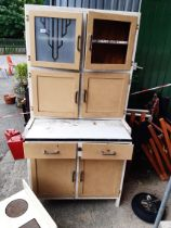 A 1930's kitchen larder cabinet with pull out enamel pastry shelf and decorative frosted glass panel