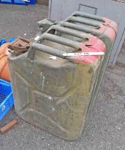 Two large green painted metal jerry cans - late 20th Century