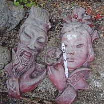A pair of Japanese style wall plaque heads