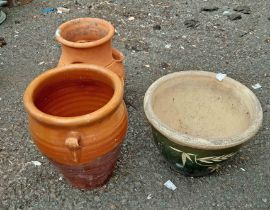 Two terracotta planters and a small terracotta strawberry pot
