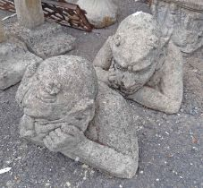 A pair of concrete gargoyles