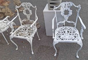 Four cast aluminium garden chairs