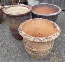 Three large garden planters, comprising one terracotta, one salt glazed stoneware and a stone