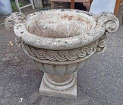 A concrete classical urn planter