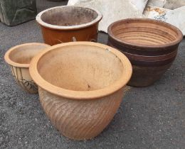 Three large garden planters of various design - sold with a another small
