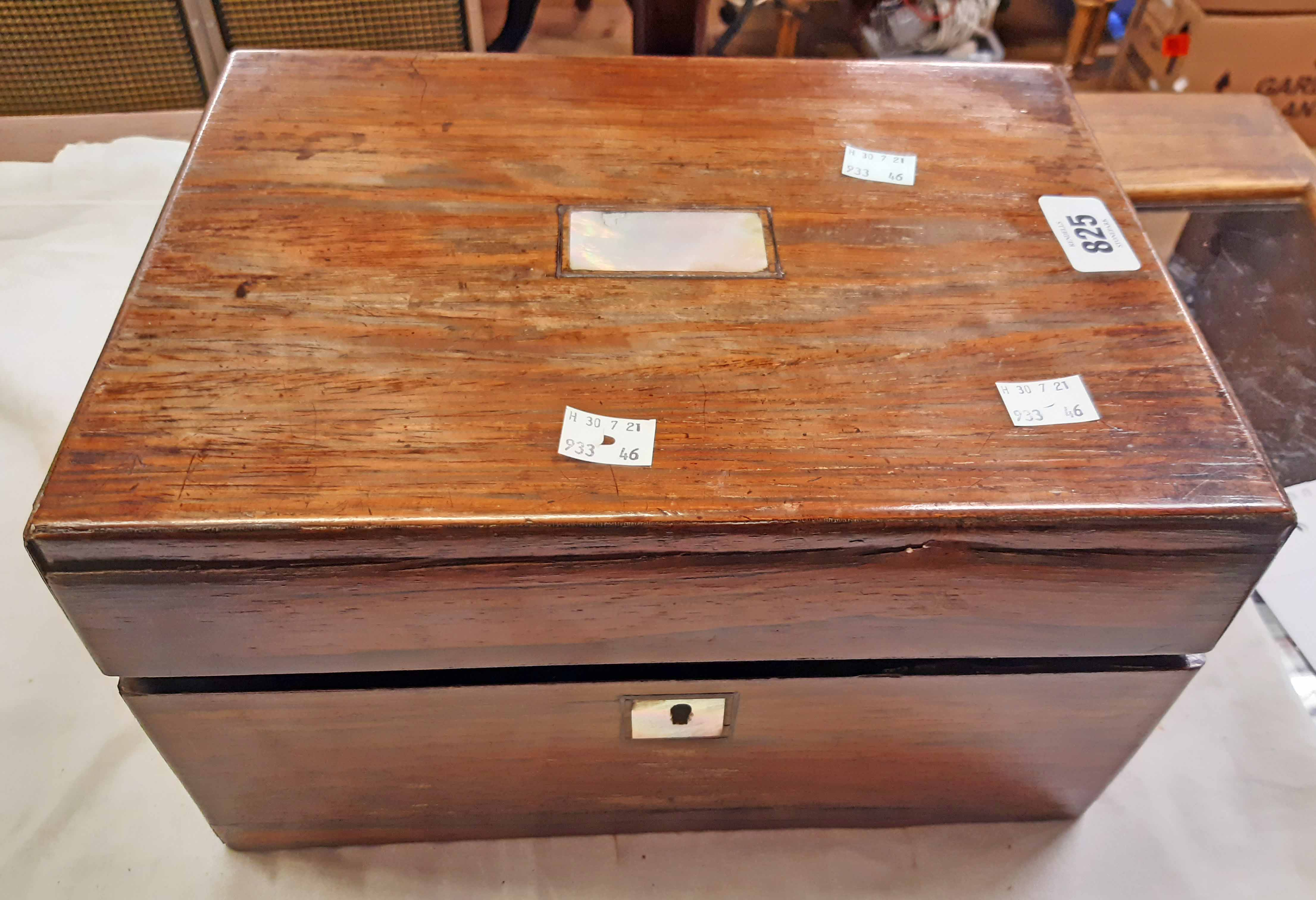A Victorian rosewood veneered travelling vanity box, the interior fitted with glass jars and boxes