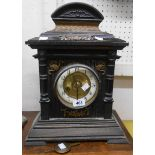 A late 19th Century German stained wood cased mantle clock with scale effect pediment and HAC