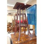 A 35cm stained wood two tier occasional table, set on swept supports