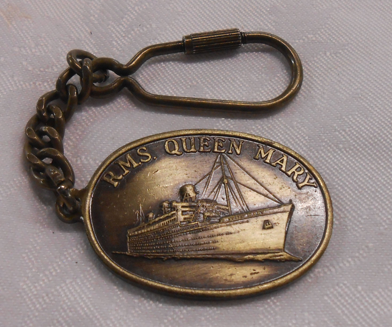A 20th Century RMS Queen Mary keyring formed from metal taken from the ship's propeller