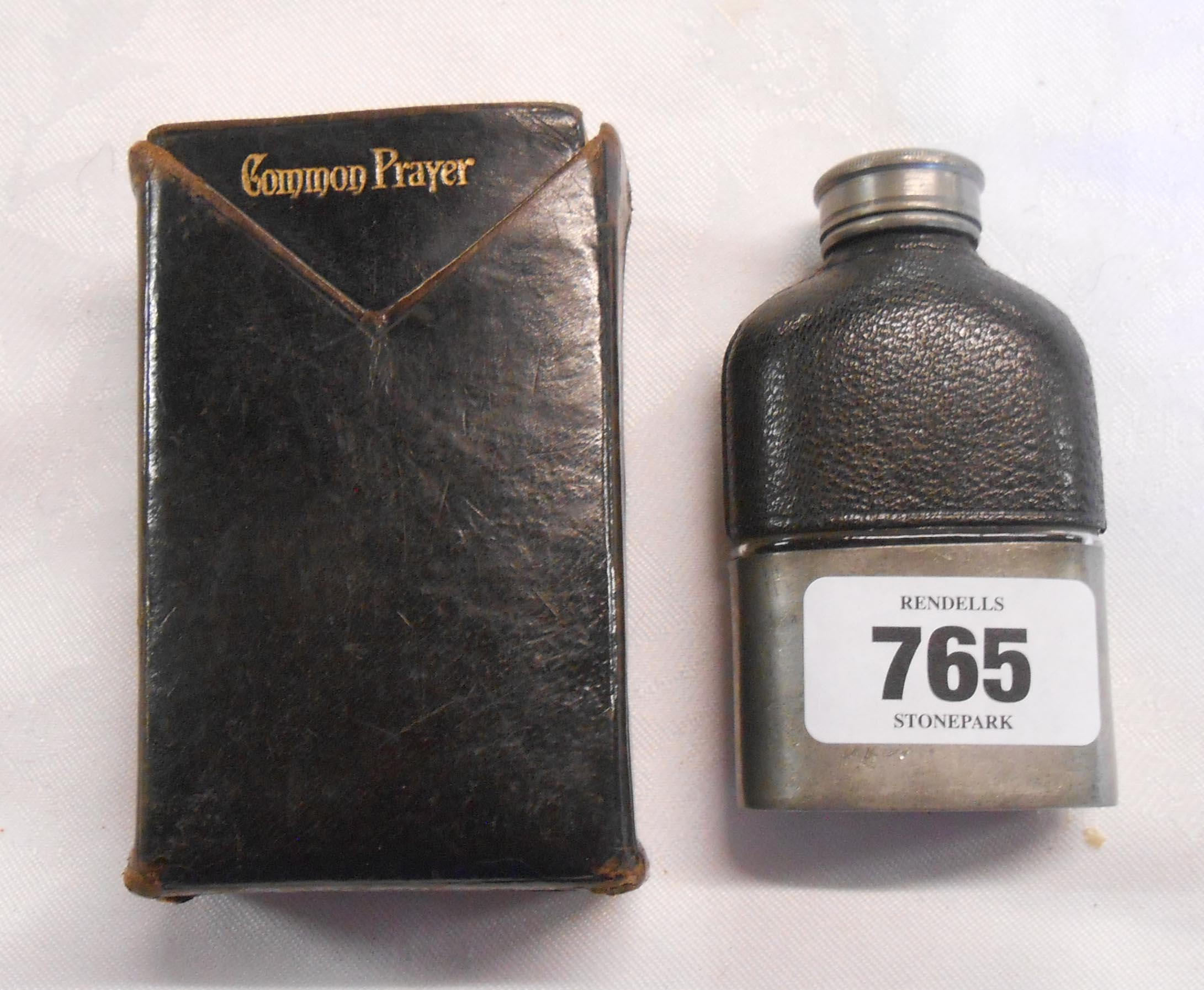 A pewter and leather clad small hipflask - sold with a leather sleeved Hymns Ancient and Modern