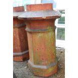 A large salt glazed stoneware chimney pot of pagoda form