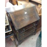 A 61cm early 20th Century polished oak bureau with part fitted interior and three long drawers