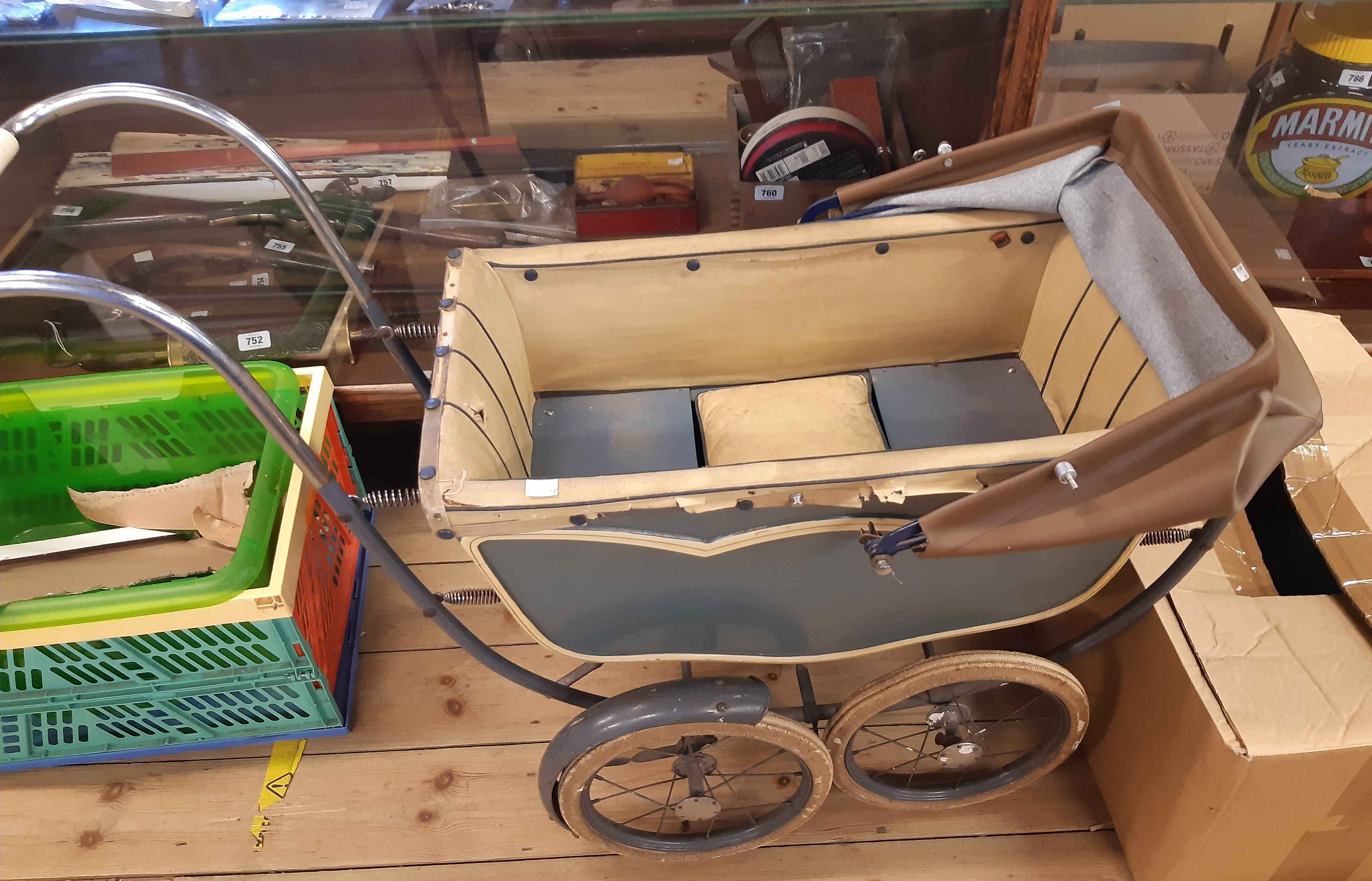 A vintage Marmet small coach built pram with original livery and hood