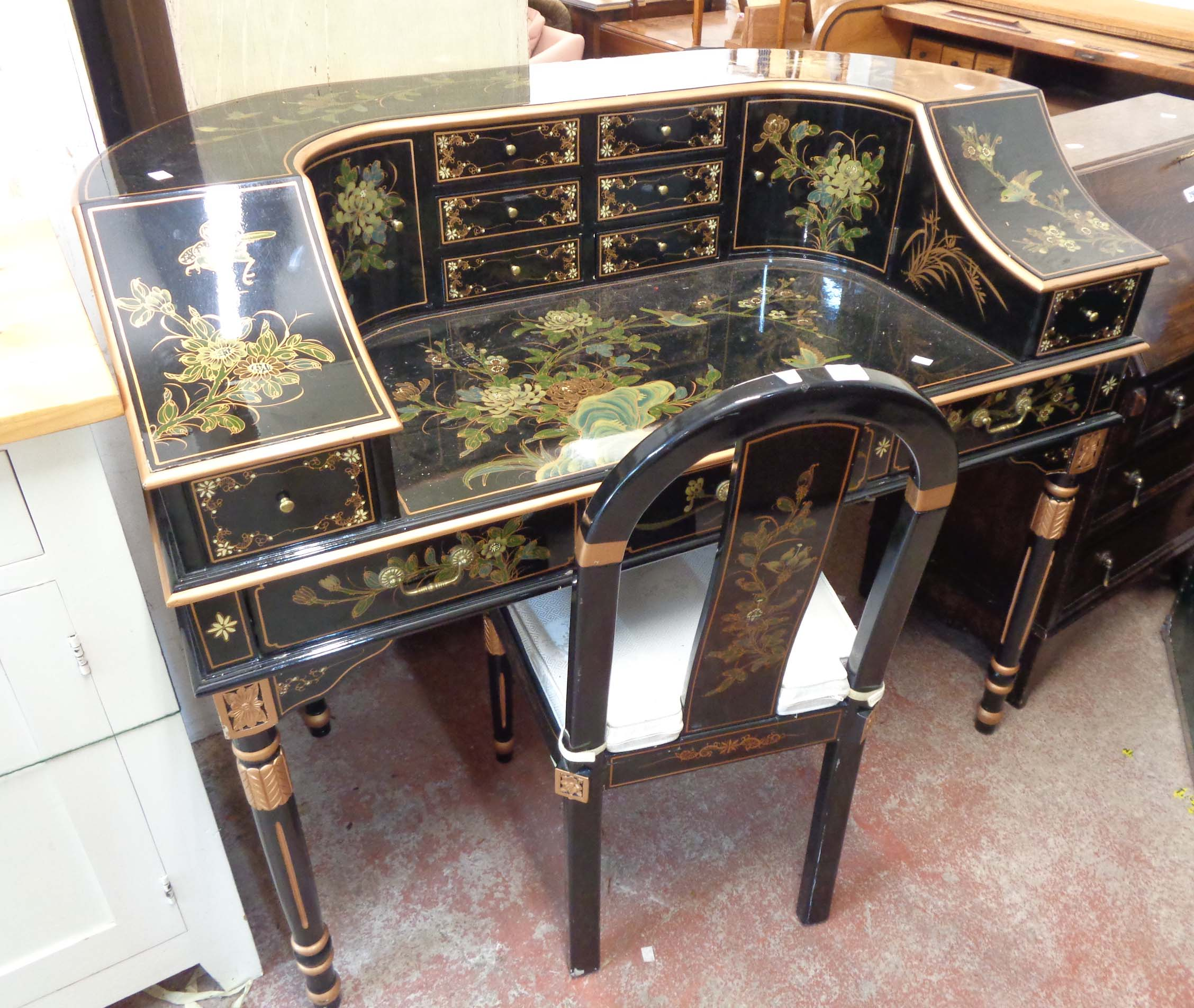 A 1.28m modern Chinese lacquered desk in the Carlton House style, highly decorated on black ground